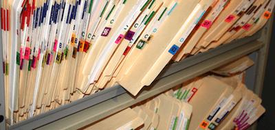 A shelf with files