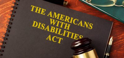 """A notebook that says """"The Americans with Disabilities Act"""" on the front"""