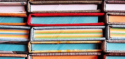 a stack of colorful books